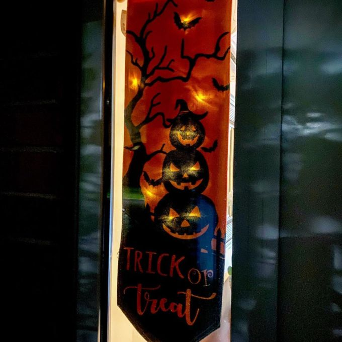 Illuminated Halloween banner with pumpkins, bats, Jack-O-Lanterns, and Trick or Treat