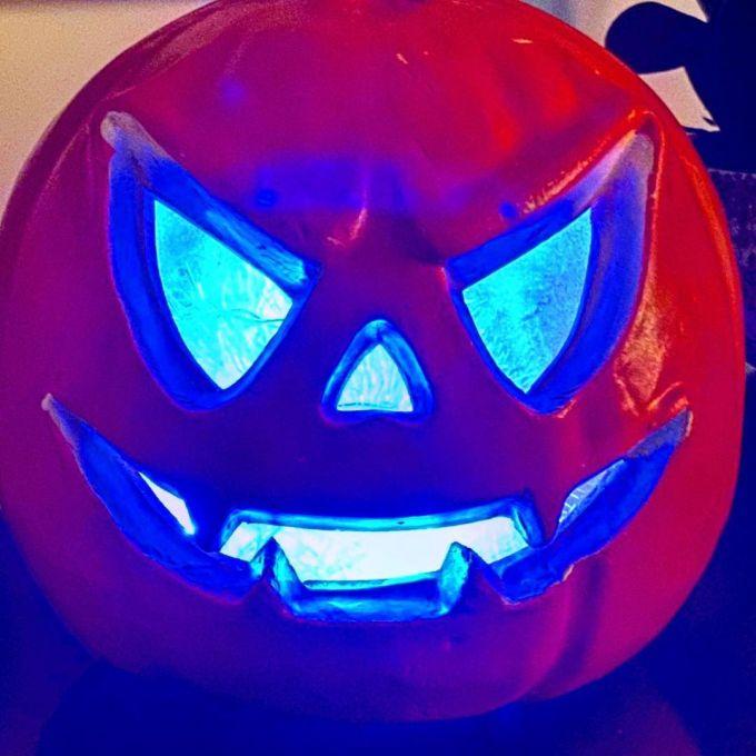 Jack-O-Lantern / Pumpkin head illuminated with blue lights