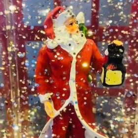 Santa Claus in Glittery Snowfall