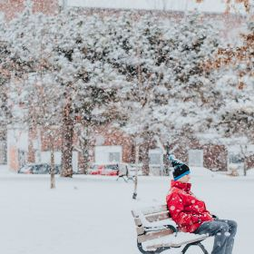 Man sitting alone on a park bench in the snow by Marcos Paulo Prado on Unsplash