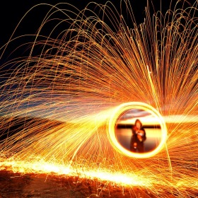 Person spinning an item causing sparks and a halo to appear