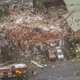House blown apart with debris over several houses due to a gas explosion on 19 July 2019 in Northwood, Christchurch, New Zealand