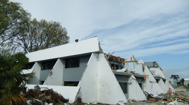 white building under demolition, October 2011