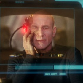 "Jean-Luc Picard holds his hand to his face as he sees his face superimposed over an image of him as Locutus of Borg 33 years earlier. Screenshot from Star Trek: Picard episode ""The Impossible Box"""