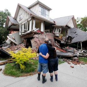Murray and Kelly James look at their destroyed house in central Christchurch, New Zealand, Wednesday, 23 February 2011, one day after the 22 February 2011 quake (Mark Baker/AP)