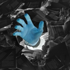 Inverse image of a hand reaching out from a sea of papers
