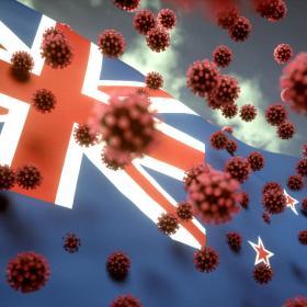 Coronavirus viruses in front of a New Zealand flag
