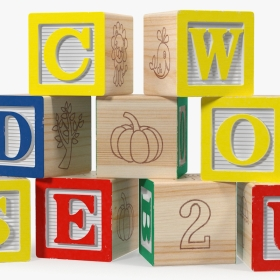 Wooden letter blocks stacked on top of one another