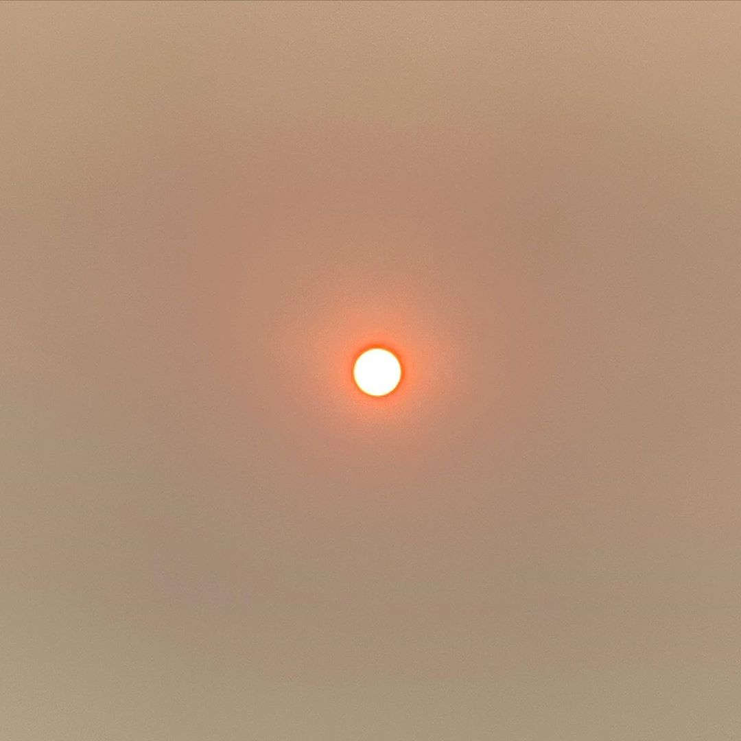 Sun looking orange in the sky with haze from fires on 2 February 2020