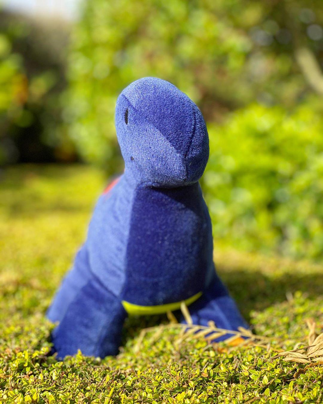 Purple Dinosaur Stuffed Animal on Top of a Hedge - 11 April 2020