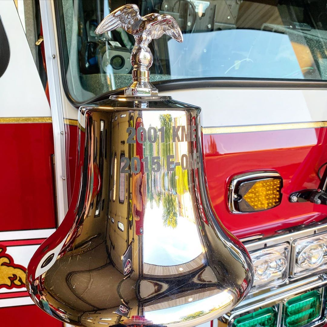 Bell with an eagle on the top attached to a fire truck