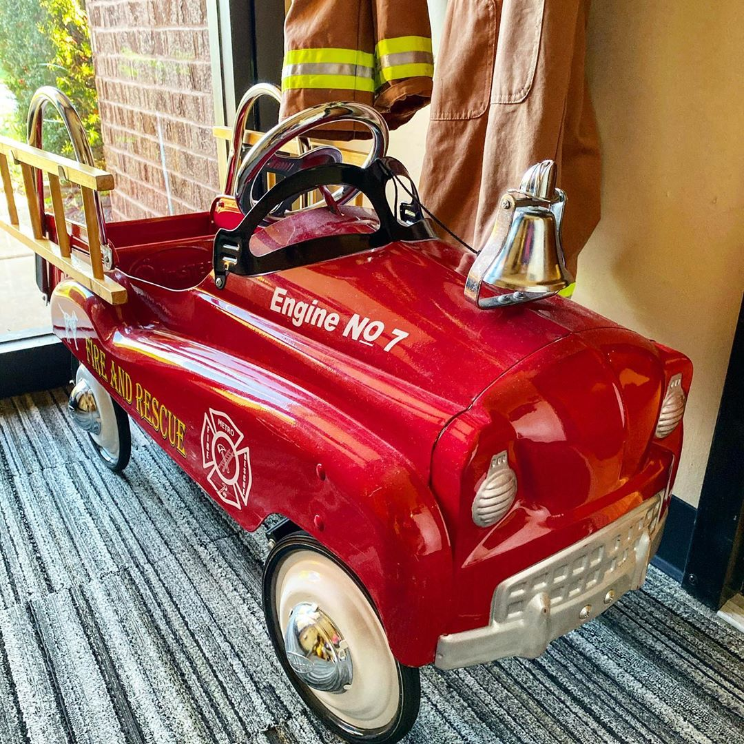 Red fire engine for children to ride in
