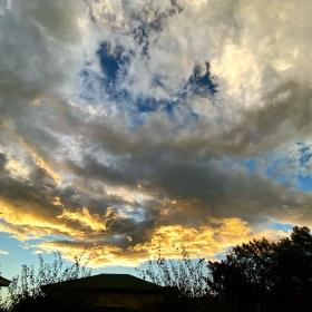 Clouds reflecting the yellows of sunset on a Nor'West'r' evening in autumn in Christchurch, New Zealand